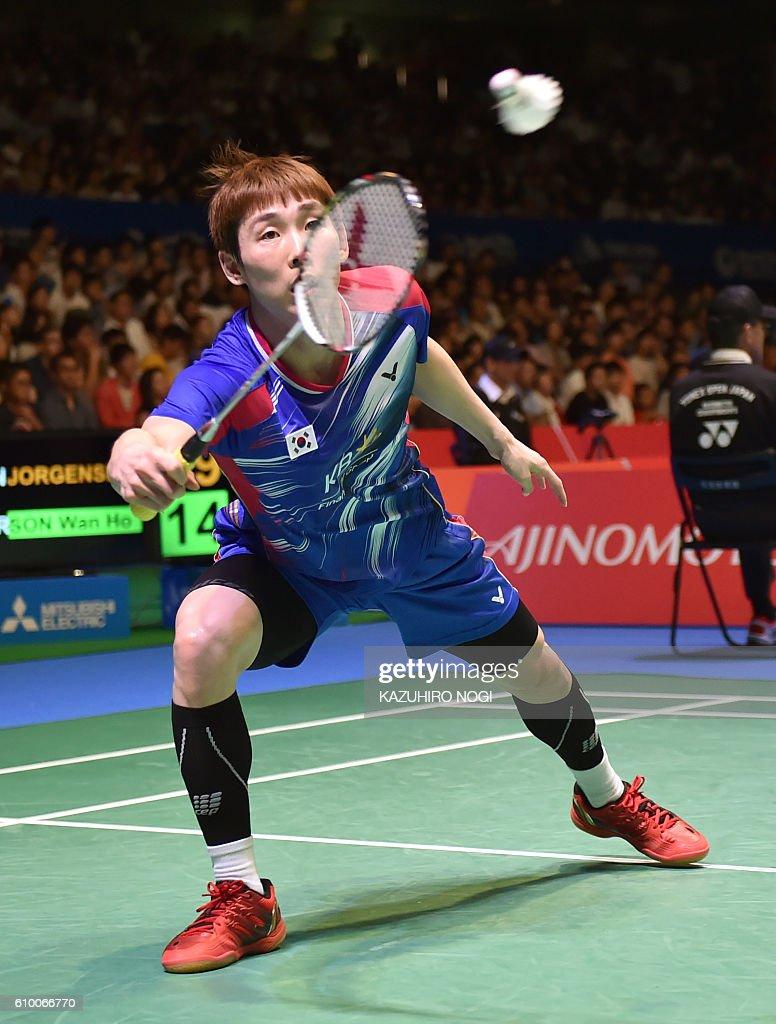 Son Wan Ho of South Korea returns a shot against Denmark s Jan O