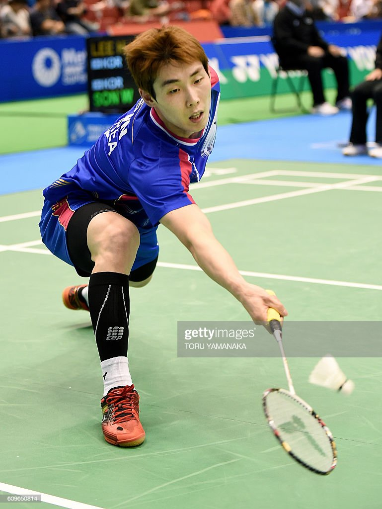 Son Wan Ho of South Korea returns a shot against his patriot