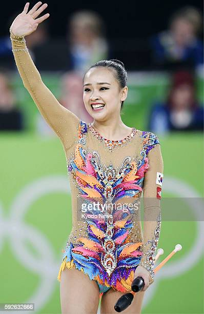 Son Yeon Jae of South Korea waves to the crowd after her performance during the rhythmic gymnastics individual allaround final at the Summer Olympics...