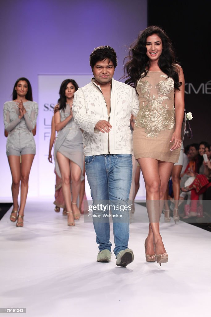 Sonal Chauhan (R) walks the runway with SS Surya (L) at Lakme Fashion Week Summer/Resort 2014 at the Grand Hyatt on March 16, 2014 in Mumbai, India.