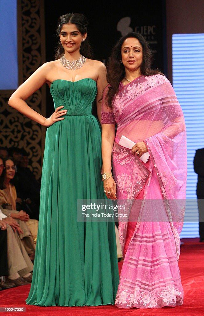 Sonam Kapoor and Hema Malini walk the ramp for Gitanjali Jewels at India International Jewellery Week (IIJW) in Mumbai on August 19, 2012.