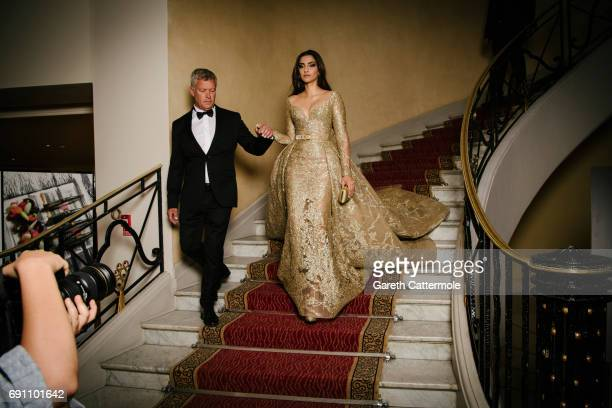 Sonam Kapoor departs the Martinez Hotel during the 70th annual Cannes Film Festival on May 22 2017 in Cannes France