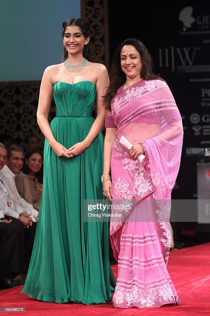 Sonam Kapoor (L) & Hema Malini (R) walk the runway in a Gitanjali design at the India International Jewellery Week 2012 Day 1 at the Grand Hyatt on on August 19, 2012 in Mumbai, India.
