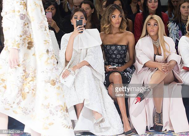 Sonam Kapoor Jourdan Dunn and Lil' Kim attend the Ralph Russo Haute Couture Fall/Winter 20162017 show as part of Paris Fashion Week on July 4 2016 in...