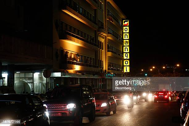 A Sonangol EP logo sits illuminated at night above passing traffic in Luanda Angola on Thursday Nov 7 2013 Angola the largest crude oil producer in...