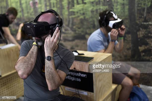Sonar attendees try VR headsets during the Sonar Festival 2015 in Barcelona on June 20 2015 The Sonar music festival a rendezvous every year in...