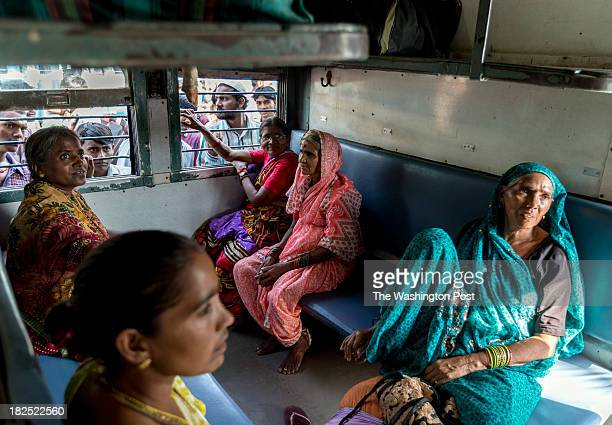 Sondi sitting with her friends from Maharashtra state in a women only carriage on a train from New Delhi's Nizamuddin Station destined for Gondwana...