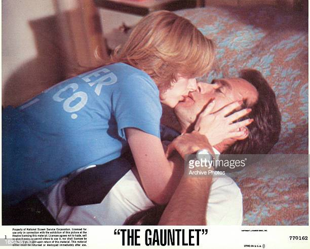 Sondra Locke kissing Clint Eastwood on the bed in a scene from the film 'The Gauntlet' 1977