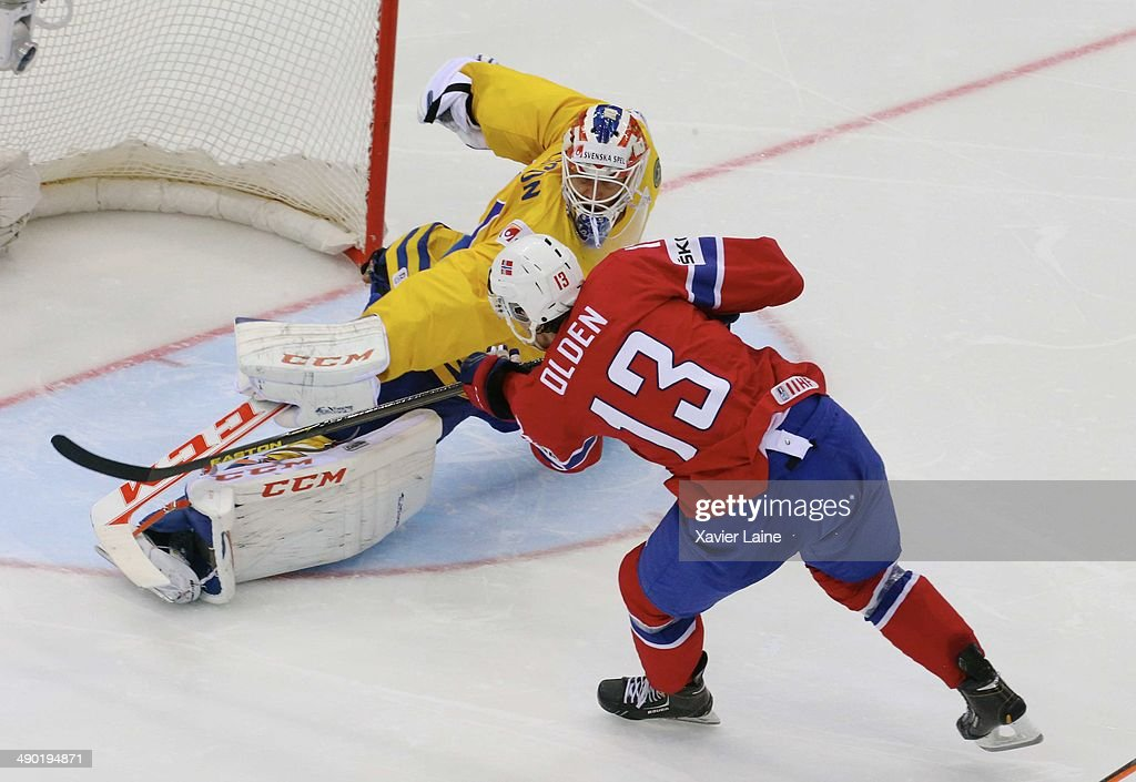 Sondre Olden of Norway (13) scores a goal during the 2014 IIHF World Championship between Sweden and Norway at Chizhovka arena on May 13, 2014 in Minsk, Belarus.