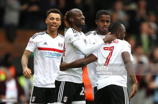 Sone Aluko of Fulham celebrates with team mates after he scores his sides third goal during the Sky Bet Championship match between Fulham and Aston...