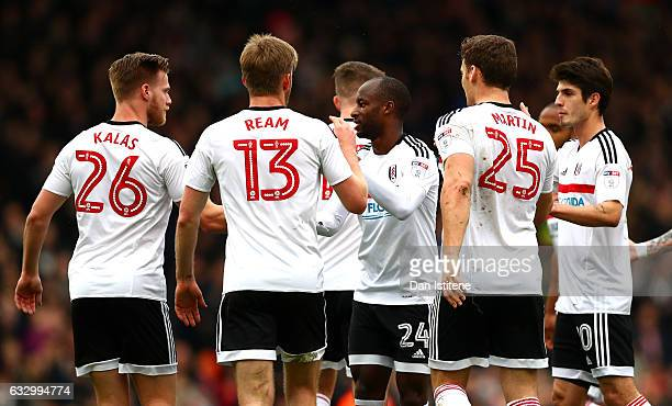 Sone Aluko of Fulham FC celebrates scoring his sides first goal with his Fulham team mates during The Emirates FA Cup Fourth Round match between...
