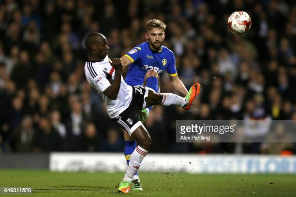 Sone Aluko of Fulham is tackled by Charlie Taylor of Leeds United during the Sky Bet Championship match between Fulham and Leeds United at Craven...