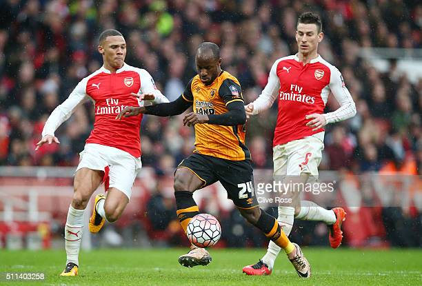 Sone Aluko of Hull City controls the ball under pressure of Kieran Gibbs and Laurent Koscielny of Arsenal during the Emirates FA Cup fifth round...