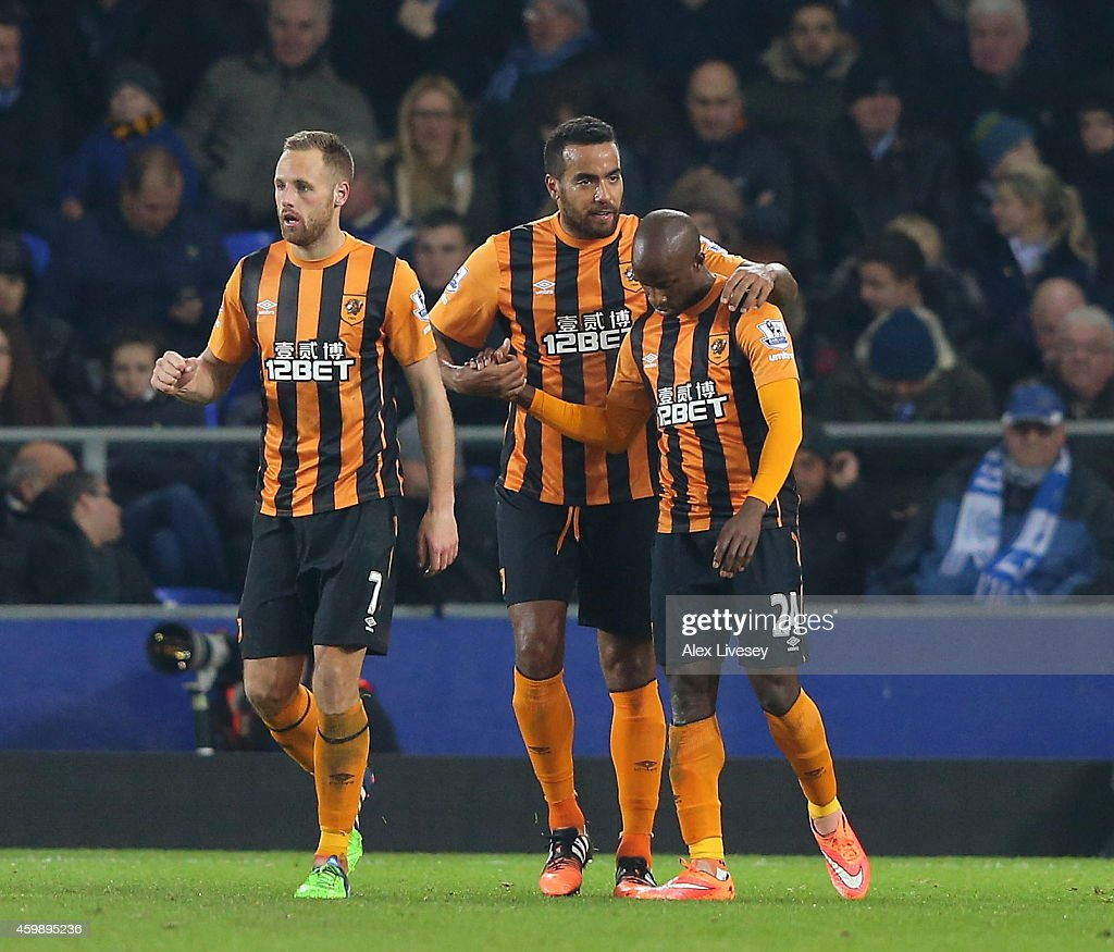 Sone Aluko #24 (R) of Hull City is congratulated by teammate Tom Huddlestone after scoring a goal to level the scores at 1-1 during the Barclays Premier League match between Everton and Hull City at Goodison Park on December 3, 2014 in Liverpool, England.