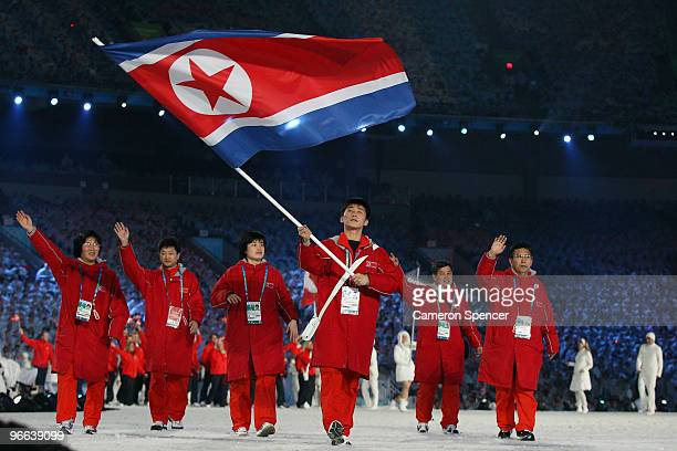Song Chol Ri of North Korea carries the national flag during the Opening Ceremony of the 2010 Vancouver Winter Olympics at BC Place on February 12...