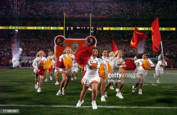 USC Song Girls cheerleaders run onto the field at the start of the FedEx Orange Bowl against Oklahoma at Pro Player Stadium in Miami Fla on Tuesday...