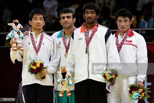 Song Jae Myung of Republic of Korea / Seyed Morad Mohammedi Pahnehkalaei of Islamic Republic of Iran Yogeshwar Dutt of India and Ri Yong Chol of...
