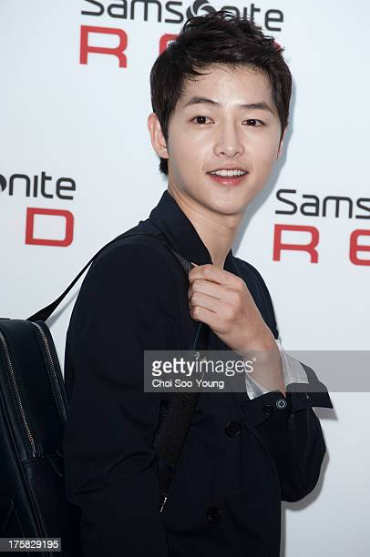 Song JoongKi attends the Samsonite Red 2013 F/W launch event at Gallery YEH on August 8 2013 in Seoul South Korea