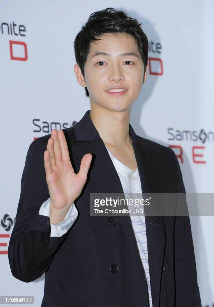 Song JoongKi attends the 'Samsonite Red 2013 F/W launch event at Gallery YEH on August 8 2013 in Seoul South Korea
