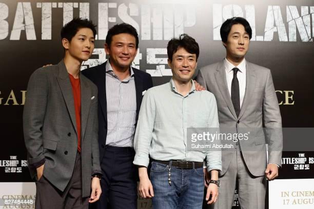 Song Joongki Hwang Jungmin Ryoo Seungwan and So Jisub pose for a photo during The Battleship Island Press Conference at Marina Bay Sands Convention...
