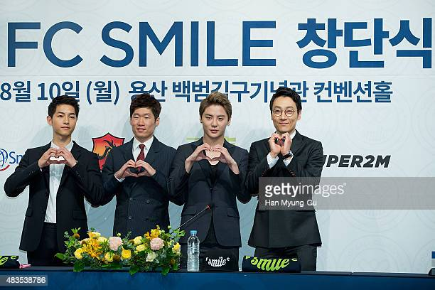 Song JoongKi Park JiSung Kim JunSu of South Korean boy band JYJ and Lee HwiJae attend the 2015 'FC Smile' Inauguration Ceremony on August 10 2015 in...