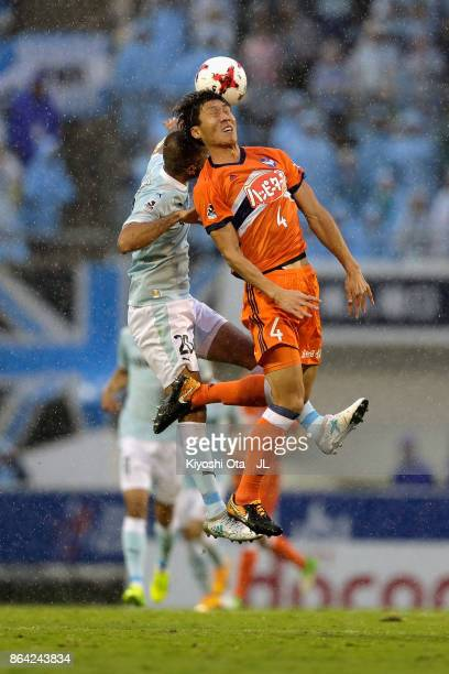Song Ju Hun of Albirex Niigata and Kengo Kawamata of Jubilo Iwata compete for the ball during the JLeague J1 match between Jubilo Iwata and Albirex...