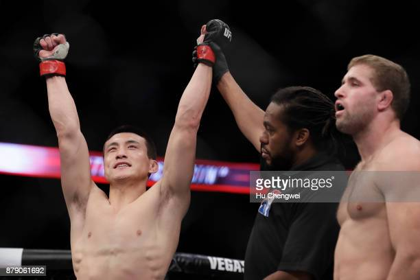 Song Kenan of China left celebrates after his victory over Bobby Nash right during the UFC Fight Night at MercedesBenz Arena on November 25 2017 in...
