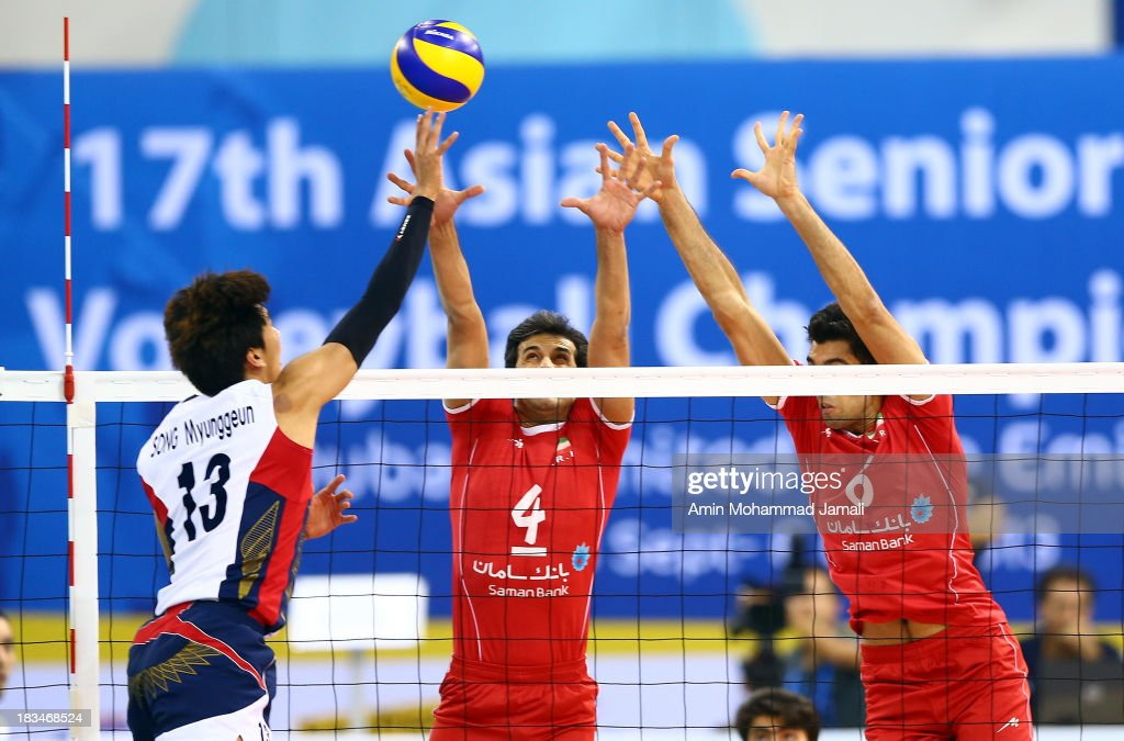 Song Meyunggeun (L) and Mir Saeed Marouf and Seyed Mohammad Mousavi during 17th Asian Men's Volleyball Championship between Iran And Korea on October 6, 2013 in Dubai, United Arab Emirates.