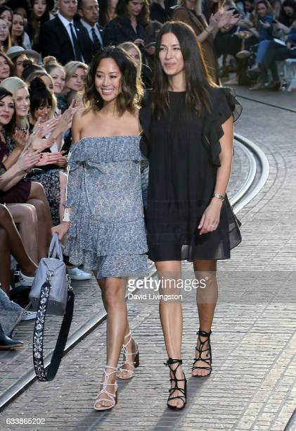 Song of Style blogger Aimee Song and designer Rebecca Minkkoff appear on the runway at Rebecca Minkkoff's 'See Now Buy Now' fashion show at The Grove...