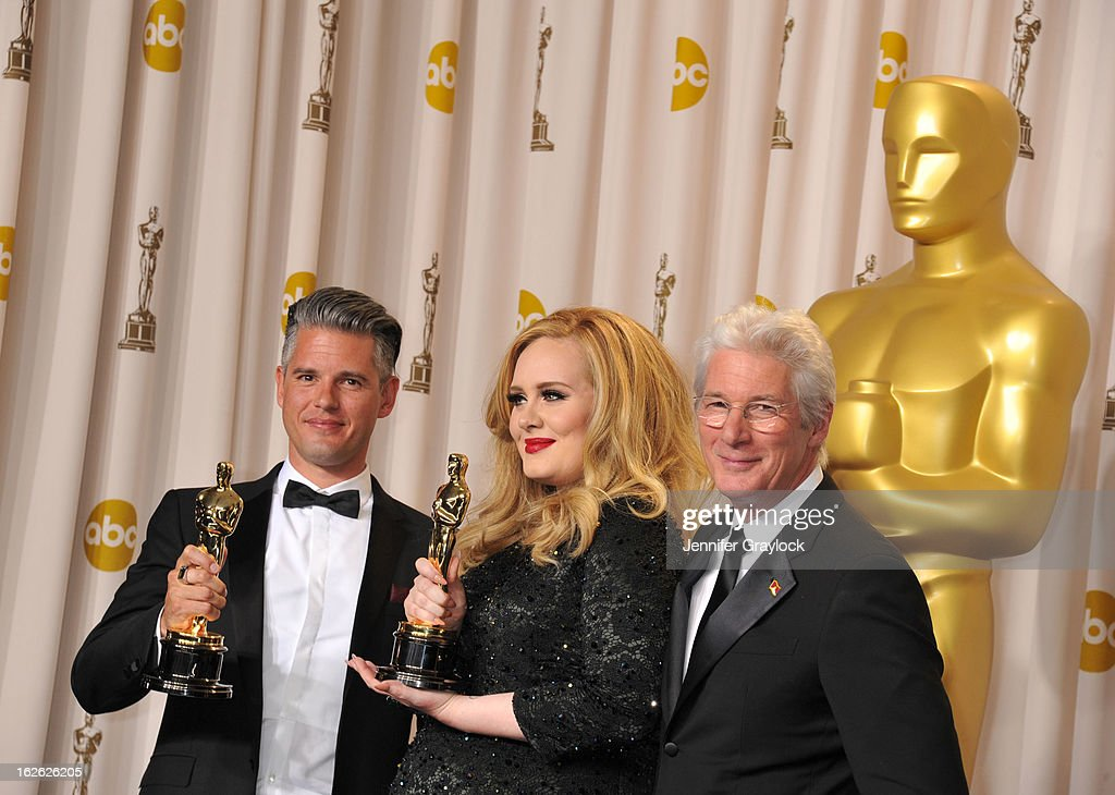 Song writer Paul Epworth, singer Adele and actor Richard Gere arrive to the 85th Annual Academy Awards Press Room held at Hollywood & Highland Center on February 24, 2013 in Hollywood, California.