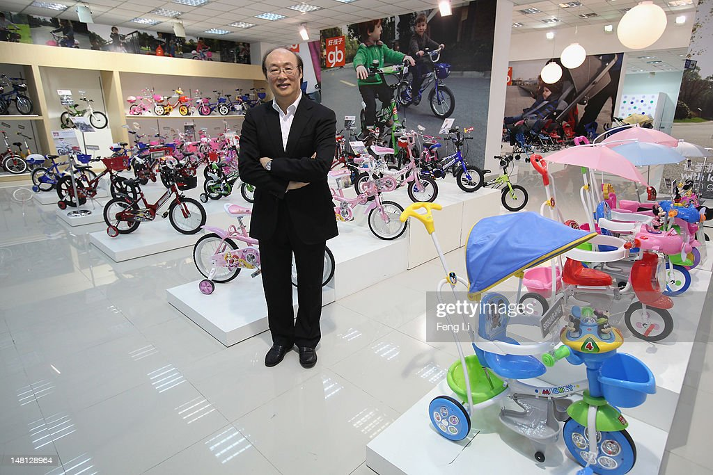 Song Zhenghuan, the President of Goodbaby Group poses in front of the children's bicycles in the exhibition hall of Goodbaby Group Co., Ltd. on July 6, 2012 in Kunshan of Jiangsu Province, China. Chinese Premier Wen Jiabao said Tuesday that stabilizing economic growth is the most pressing matter currently facing China. China's central bank's sudden cut in the benchmark interest rates for the second time in a month confirmed the pessimistic view of the current economic situation.