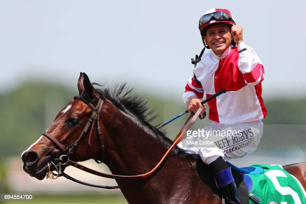 Songbird with Jockey Mike Smith celebrates after winning The Ogden Phipps during the 149th running of the Belmont Stakes at Belmont Park on June 10...