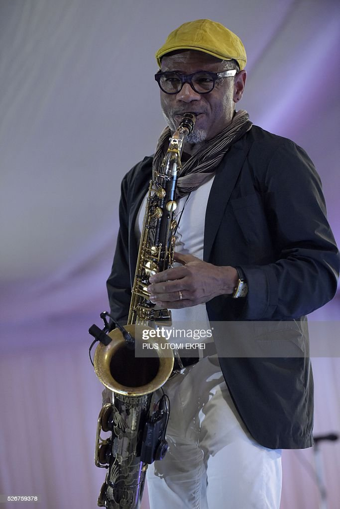 US songwriter and jazz saxophonist Kirk Whalum plays his saxophone during International Jazz Day in Lagos on April 30, 2016. Jazz enthusiasts gathered at the government house in Lagos, Nigeria's commercial capital to mark the International Jazz Day, a global event designed to highlight jazz, its roots, future, impact and its diplomatic role of uniting people across the world. / AFP / PIUS