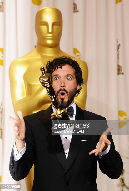 Songwriter Bret McKenzie accepts the Best Original Song Award for 'Man or Muppet' from 'The Muppets' poses in the press room at the 84th Annual...