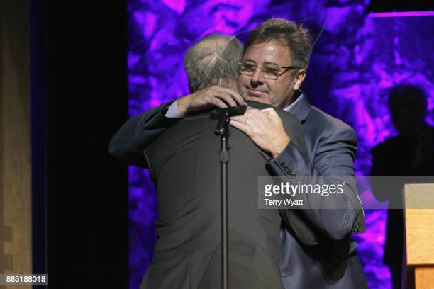 Songwriter Don Schlitz receives medallion from Vince Gill onstage at the Country Music Hall of Fame and Museum Medallion Ceremony to celebrate 2017...