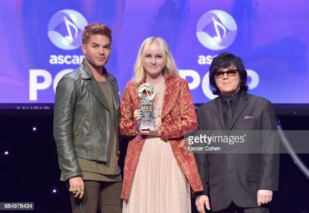 Songwriter Doris Sandberg accepts the award for 'Songwriter of the Year' with singer Adam Lambert and ASCAP EVP of Membership John Titta onstage at...