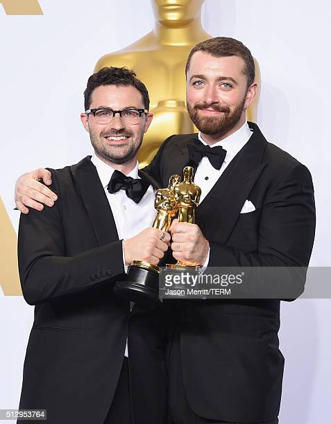 Songwriter Jimmy Napes and singer Sam Smith winners of the award for Best Original Song 'Writing's on the Wall' pose in the press room during the...