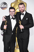 Songwriter Jimmy Napes and singersongwriter Sam Smith winners of the Best Original Song award for 'Writing's on the Wall' from 'Spectre' pose in the...