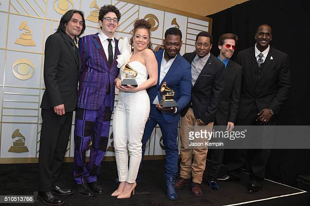 Songwriter Kendra Foster and The Vanguard celebrate her Best RB Song trophy for 'Really Love' in the press room during The 58th GRAMMY Awards at...