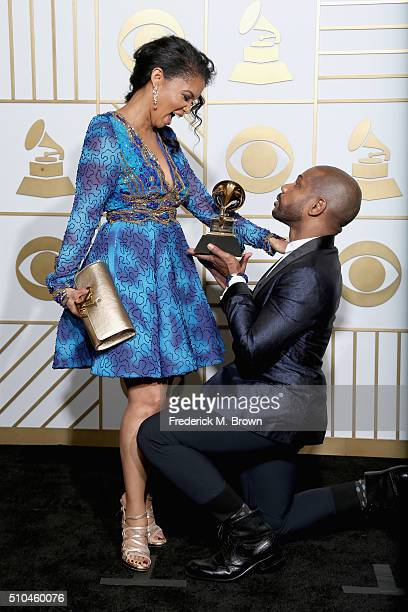 Songwriter Kirk Franklin holds his Best Gospel Performance/Song trophy for 'Wanna Be Happy' with Tammy Collins pose in the press room during The 58th...