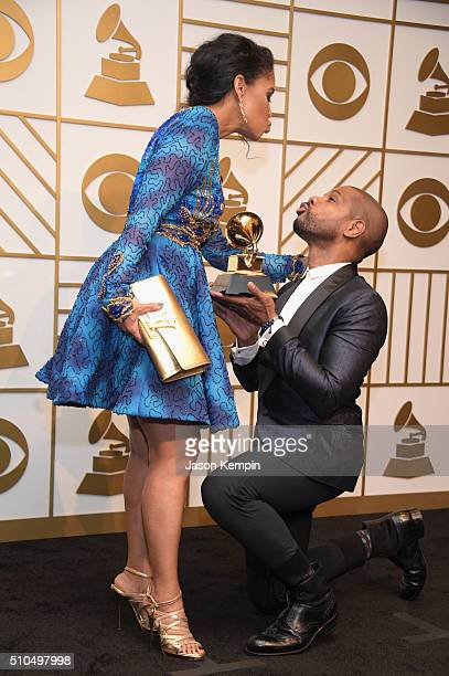 Songwriter Kirk Franklin holds his Best Gospel Performance/Song trophy for 'Wanna Be Happy' with Tammy Collins poses in the press room during The...