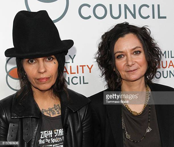 Songwriter Linda Perry and TV personality Sara Gilbert attend the Family Equality Council Impact Awards on March 12 2016 in Beverly Hills California