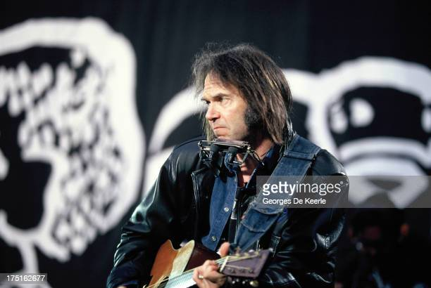 Songwriter Neil Young performs at a concert held at Wembley Stadium to celebrate the release of African National Congress leader Nelson Mandela from...