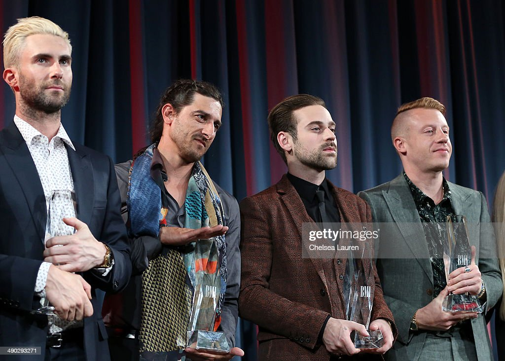 BMI Songwriter of the Year Award winners <a gi-track='captionPersonalityLinkClicked' href=/galleries/search?phrase=Adam+Levine+-+Singer&family=editorial&specificpeople=202962 ng-click='$event.stopPropagation()'>Adam Levine</a>, <a gi-track='captionPersonalityLinkClicked' href=/galleries/search?phrase=Jeff+Bhasker&family=editorial&specificpeople=8901106 ng-click='$event.stopPropagation()'>Jeff Bhasker</a>, Ryan Lewis and <a gi-track='captionPersonalityLinkClicked' href=/galleries/search?phrase=Macklemore&family=editorial&specificpeople=7639427 ng-click='$event.stopPropagation()'>Macklemore</a> attend the 2014 BMI Pop Awards at the Beverly Wilshire Four Seasons Hotel on May 13, 2014 in Beverly Hills, California.