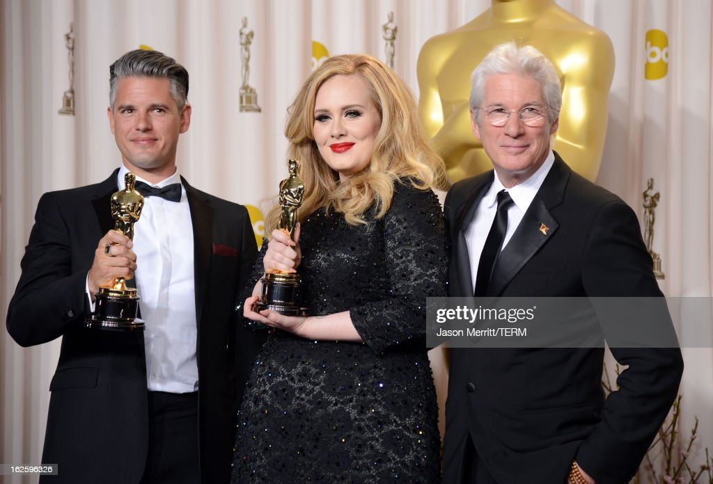 Songwriter Paul Epworth and singer Adele winners of the Best Original Song award for 'Skyfall' with presenter Richard Gere pose in the press room...