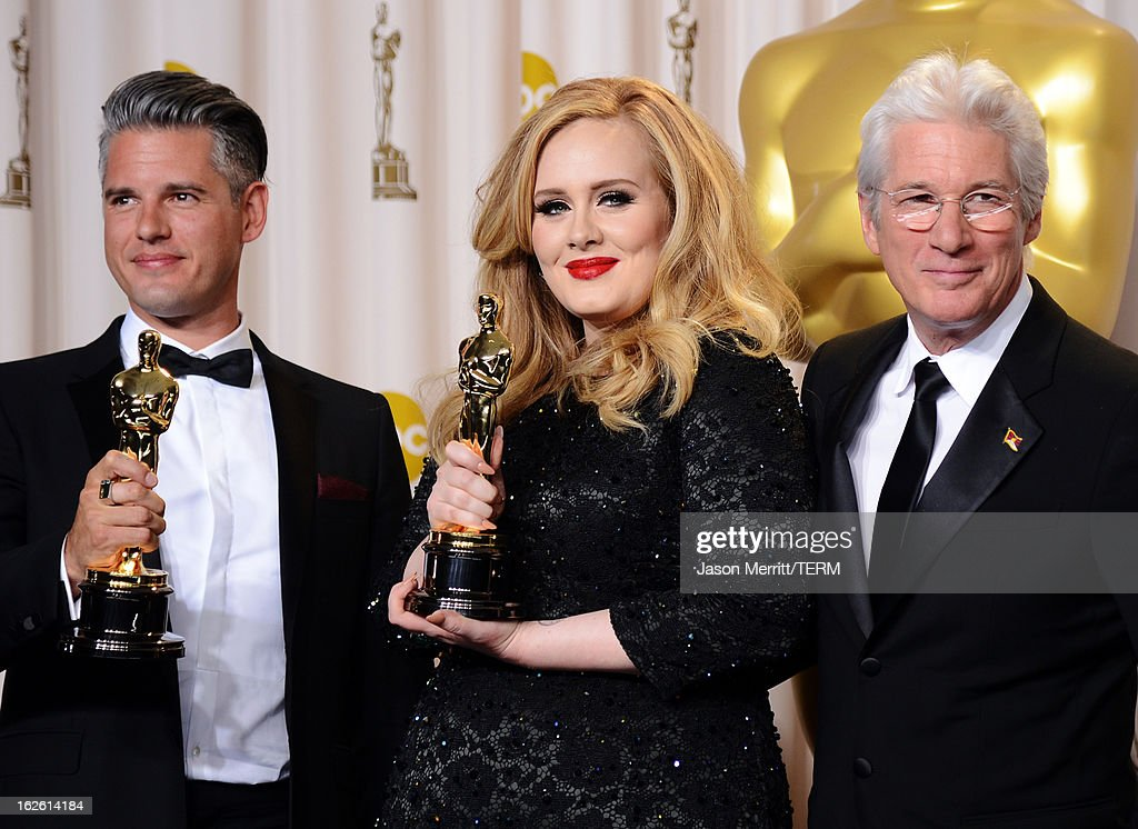 Songwriter Paul Epworth and singer Adele, winners of the Best Original Song award for 'Skyfall,' with presenter Richard Gere pose in the press room during the Oscars held at Loews Hollywood Hotel on February 24, 2013 in Hollywood, California.
