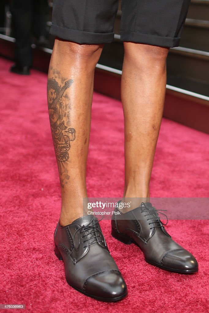 Songwriter <a gi-track='captionPersonalityLinkClicked' href=/galleries/search?phrase=Pharrell+Williams&family=editorial&specificpeople=161396 ng-click='$event.stopPropagation()'>Pharrell Williams</a> (shoe and tattoo detail) attends the Oscars at Hollywood & Highland Center on March 2, 2014 in Hollywood, California.