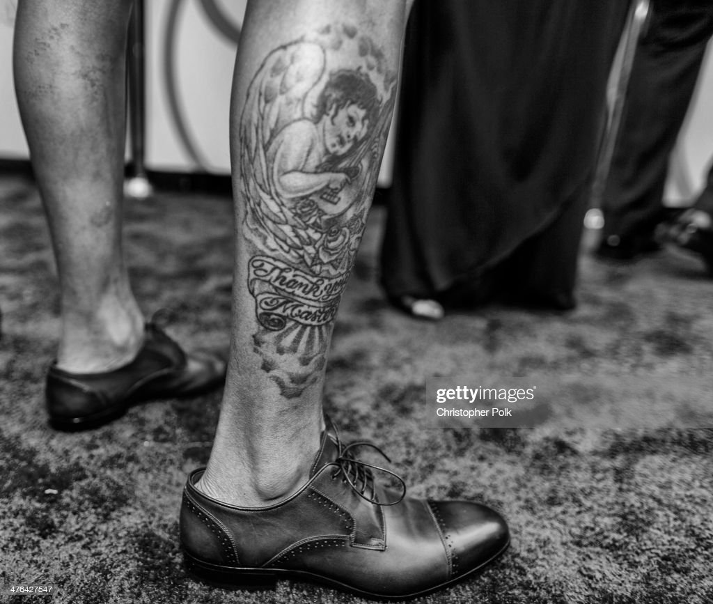 Songwriter Pharrell Williams (shoe and tattoo detail) attends the Oscars at Hollywood & Highland Center on March 2, 2014 in Hollywood, California.