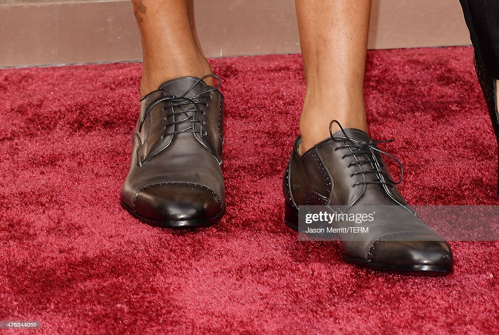 Songwriter Pharrell Williams (shoe and tattoo detail) attends the Oscars held at Hollywood & Highland Center on March 2, 2014 in Hollywood, California.