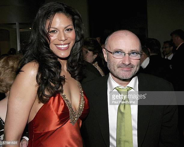 Songwriter Phil Collins and actress Merle Dandridge attend the opening night of 'Tarzan' after party at The New York Marriott Marquis May 10 2006 in...